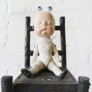 Baby Is Watching You – Antique German Bisque Doll in a Cast Iron High Chair